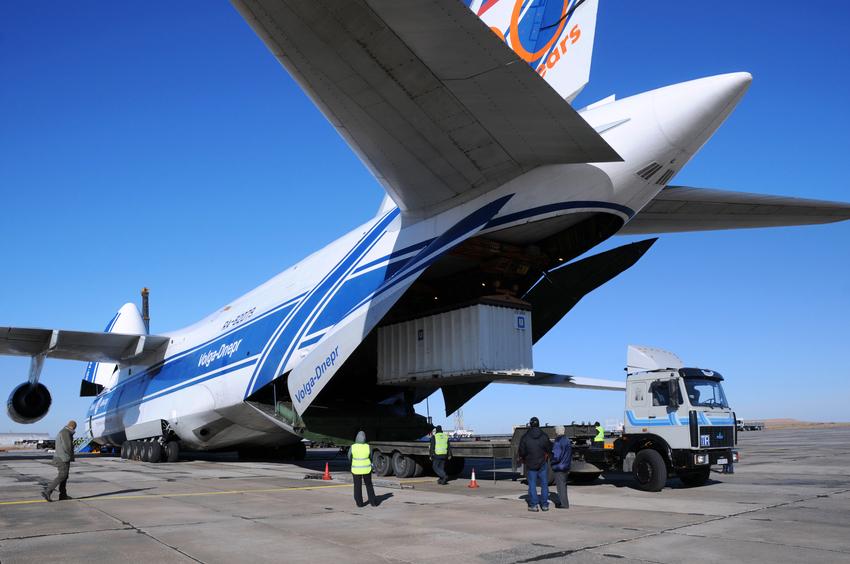 Baikonur, Kazakhstan - November 11, 2013: Russian Volga-Dnepr Antonov AN-124 long-range heavy transport plane is being unloaded in Yubileiny airport.