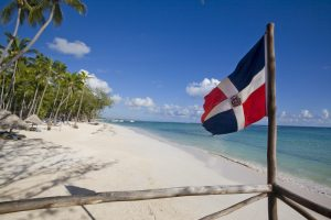 Dominican republic flag in the beach
