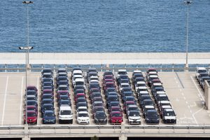 Vehicles waiting for transport at the customs car park in Portvell of Barcelona, Spain