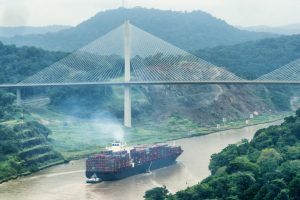Cargo ship and Centerary Bridge on Panama Canal